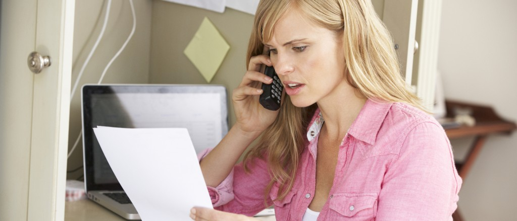 Woman Working In Home Office On Phone