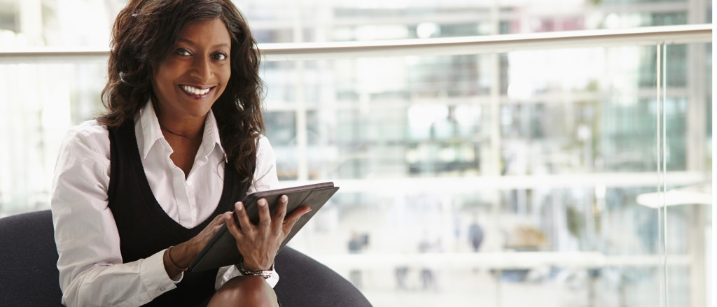 Mixed race businesswoman using digital tablet, to camera